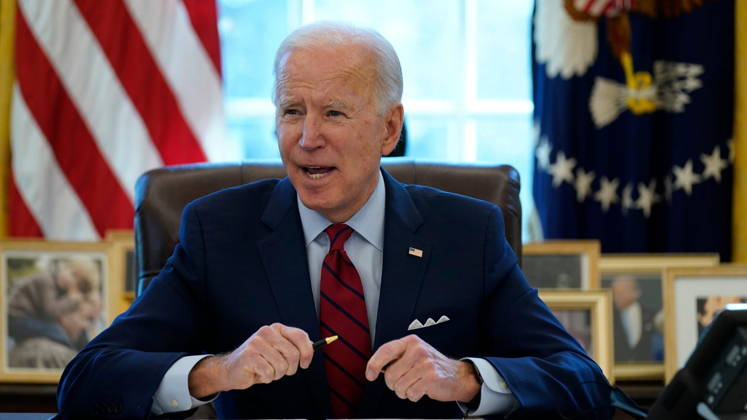 Joe Biden working from the Oval Office in January (AP Photo/Evan Vucci)