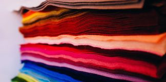 Stacked colored clothing fabric.
