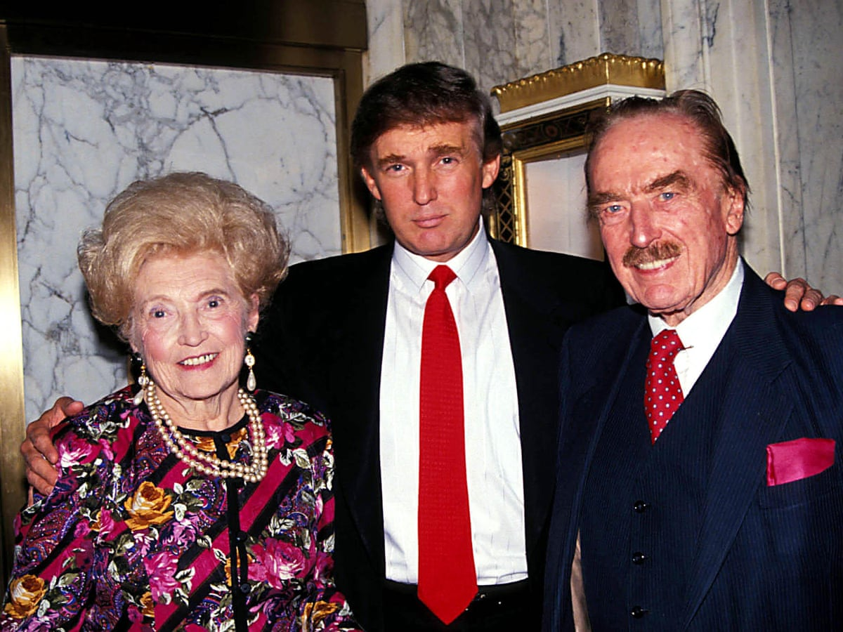 Donald Trump (center) with his mother Mary and father Fred in New York in 1994
