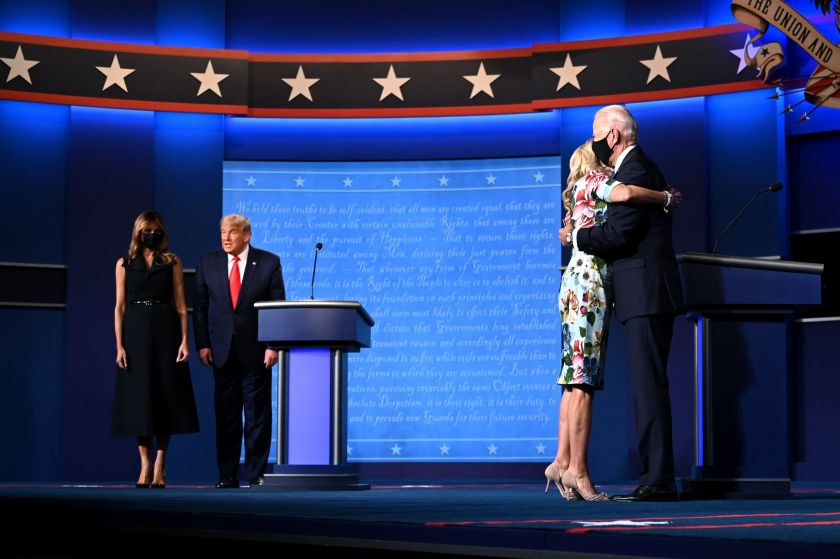President Joe Biden and First Lady, Jill Biden on stage hugging after 2020  presidential debate.(AFP / Getty Images)